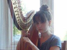 Zoe Playing the Harp