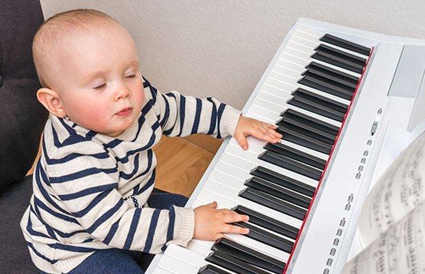 Small baby at a piano